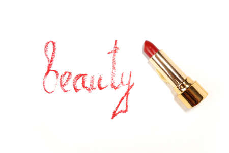Red lipstick, word in English made with lipstick. Isolated on white