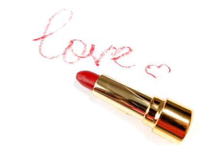 Red lipstick, word in English made with lipstick. Isolated on white          写真素材