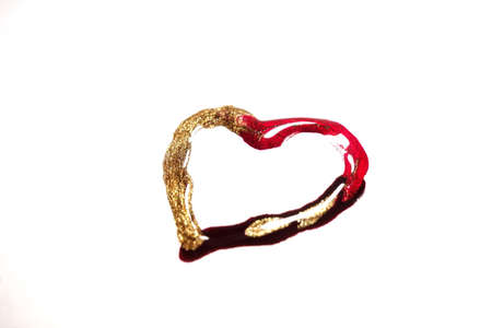 Nail polish heart isolated on white. Red, gold and black colour.Nail accessories. Beauty and fashion supplies Reklamní fotografie