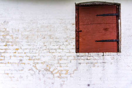 a wall and a contrasty old window of a danish farm