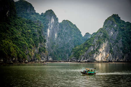 cloudy day of navigation inside of the dragon in halong bay vietnam