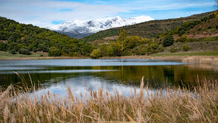 Natural landscape composed of snowy mountains and a lake inside. Stock Photo