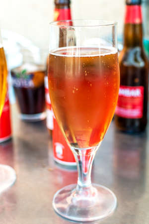 Take something among friends. Different types of drinks on the table such as beer glasses, cola glasses ...