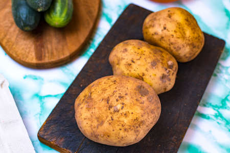 Food from the garden of Spain such as potatoes and cucumbers.