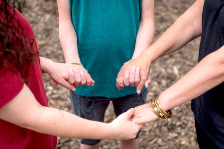 Union symbol. Family shaking hands in a circle.