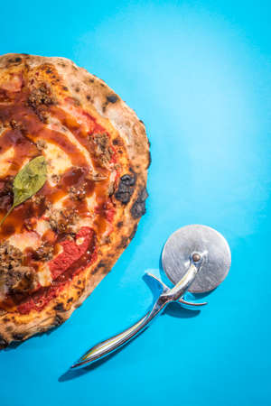 Pizza with meat and barbecue sauce with blue color background Stock Photo