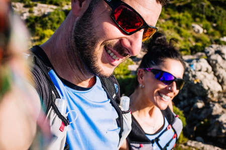 Woman and man mountain runners taking a selfie.