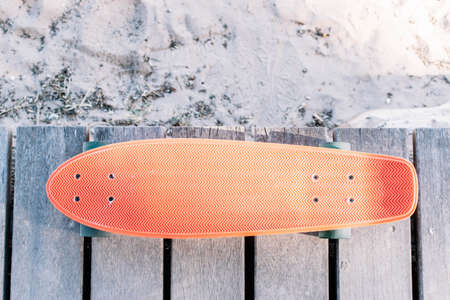 skateboard penny on a wooden boardwalk on the beach