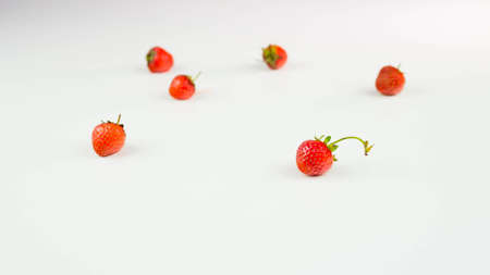 Strawberries on a white background, close-up. Ripe and juicy strawberries.