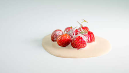 Strawberry in yogurt, milk mix with fruit, on a white background, close-up.