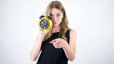 Young girl in a black dress with a retro clock.