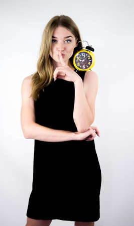 Beautiful girl with a retro watch, on a white background.