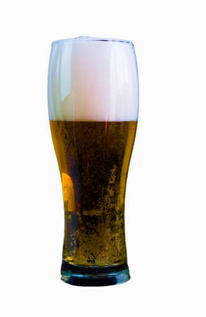 Glass of light beer on an isolated white background, draft beer fresh in a glass.
