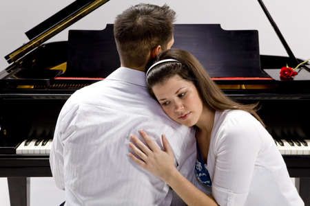 Couple with Grand piano 3 sitting at piano bench with red rose Stock Photo - 7109971