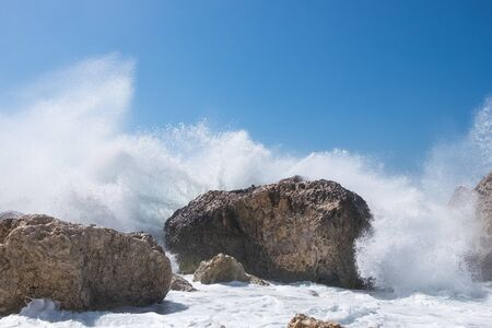 power giant: Stormy ocean striking the rocks