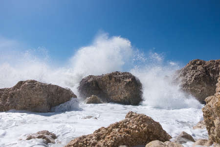 power giant: Stormy giant waves crash on the rocks Stock Photo