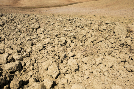 Plowed field ready to be cultivated in Val dOrcia, Tuscany