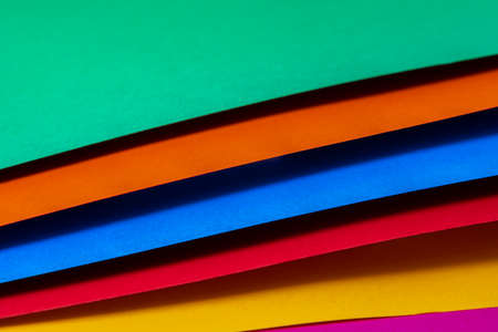 green, orange, blue, red, yellow and violet colored papers with shadow
