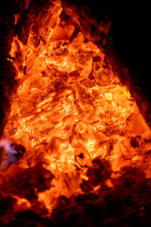 Close-up of a wood fire with lots of red-hot coals