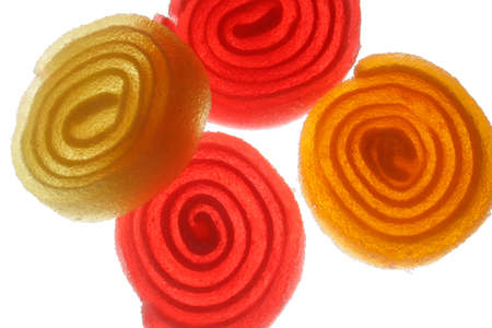 yellow and red spirals of sugar on a white background