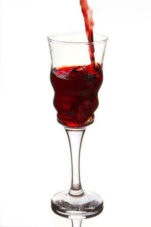 Crystal glass that slowly fills with a refreshing and red wine.