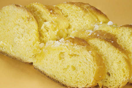 Delicious bagel decorated with sugar on a yellow background. Typically at parties and celebrations.