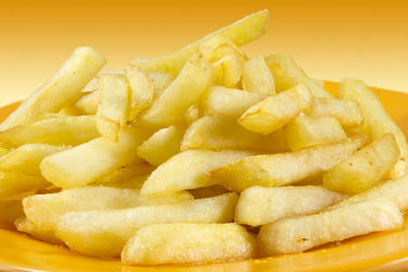 free stock photos: Plate of chips on a gradient background in yellow.
