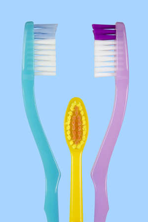 Toothbrushes for dad, mom and son on a blue background. photo