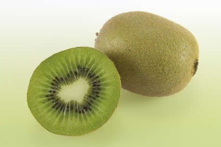 Photograph of a kiwi in half open where you can see the shape of a heart, representing good health.