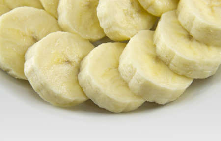 royalty free stock photos: Close up of a banana slices with sugar on a white plate.