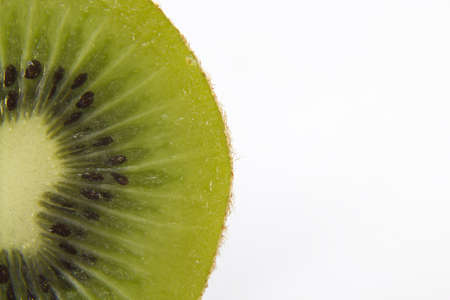 Close up of a green and healthy juicy kiwi on a white background.