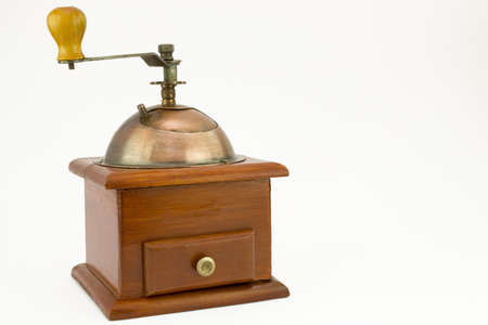 Picture of an old coffee mill on a white background