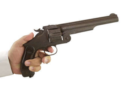 Photo of a hand holding a gun on a white background.