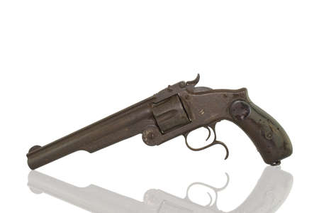 Photo of an old pistol on a white background.