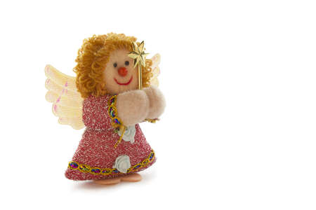 Photo of a Christmas angel of rag with a star on a white background. Stock Photo