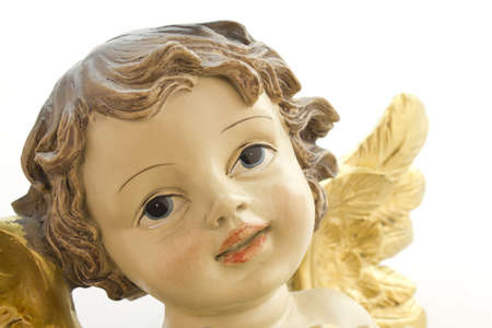 Photo of the face of a Christmas angel on a white background.
