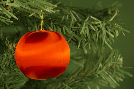 Close-up of a red ball hung on the Christmas tree. Stock Photo - 16442005