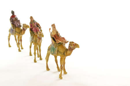 melchor: The three wise men going to Bethlehem on a white background.