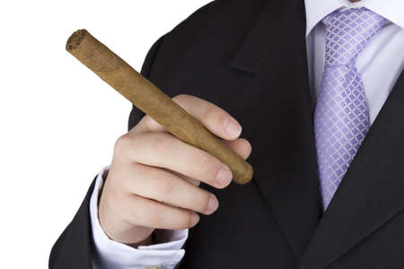 Photo of a businessman smoking a cigar on a white background