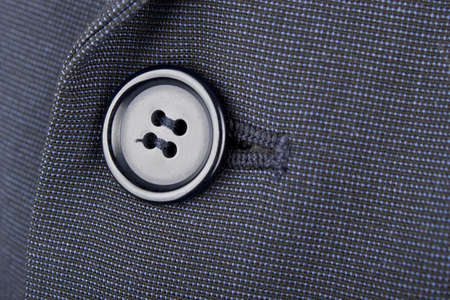 Close up of a black button on a man Stock Photo - 16724949