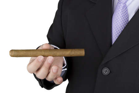 Photo of an elegant man showing his cigar on a white background Stock Photo - 16724929