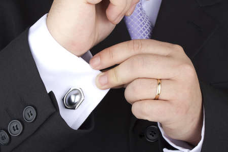cufflinks: Photo of an fiance dressing the day of his wedding  Stock Photo