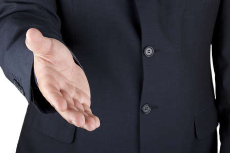 Photo of a businessman offering his hand to greet the viewer  Stock Photo