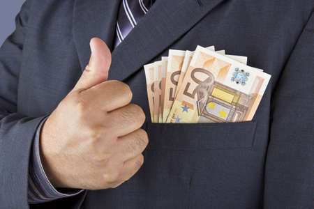 Man very happy to have a lot of money in his pocket  Stock Photo - 16724950