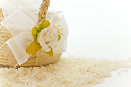 Close up to the little basket of rice for wedding on a white background.