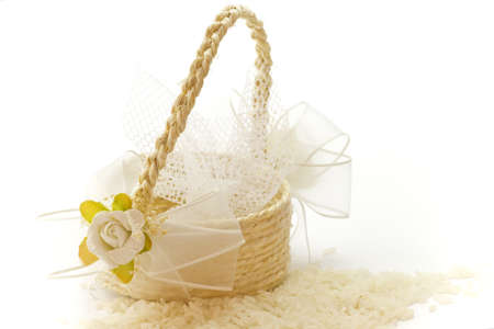 Little basket of rice for wedding on a white background. Stock Photo