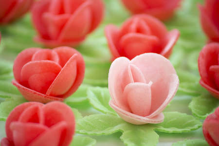 Texture formed by several pink and red flowers of wafer.