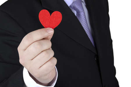 Man gives a fabric heart to the camera on a white background.