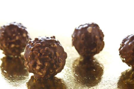 hazelnut chocolate balls on a white background