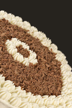 chocolate shavings: chocolate shavings and cream from a cake Stock Photo